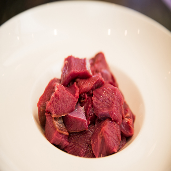 Diced wild venison steak