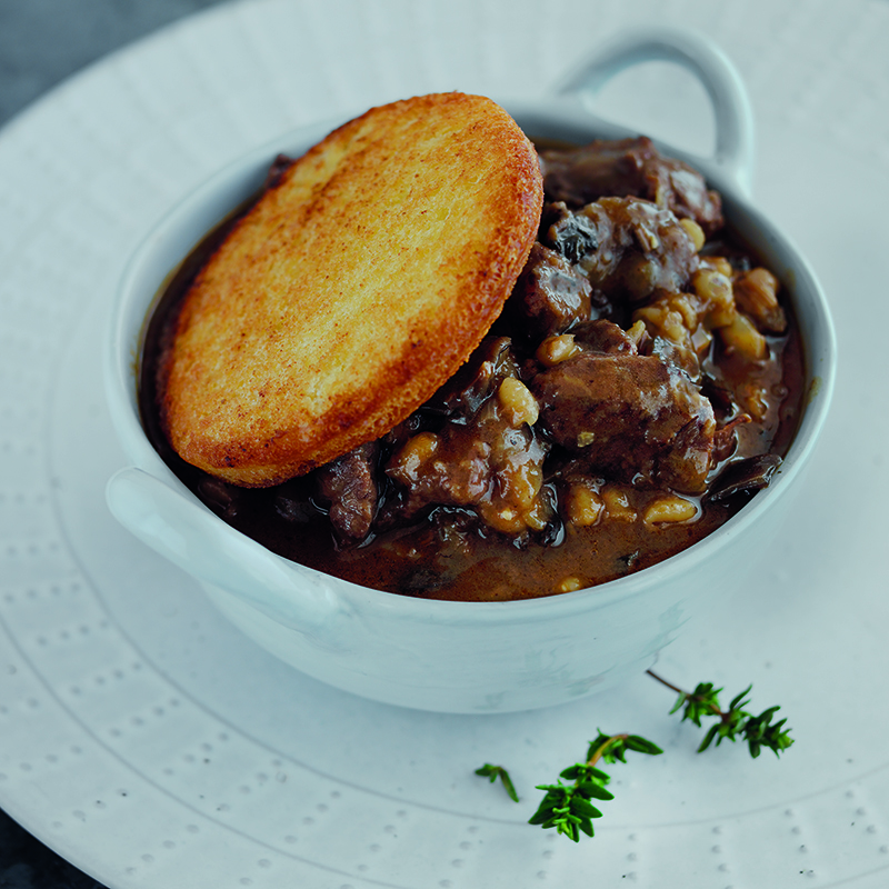 Venison, porcini mushroom and red wine stew with pearl barley and a golden bread croute