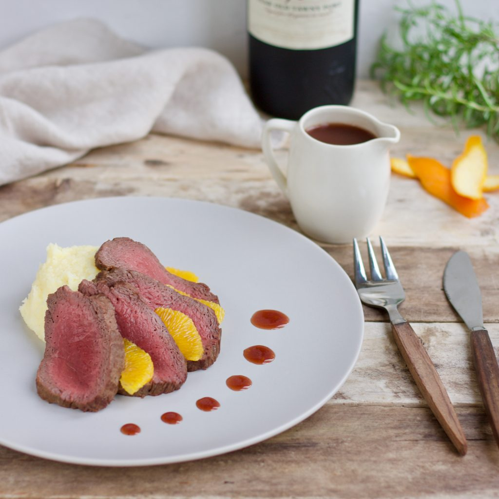 Pan-fried Venison with Orange, Port and Redcurrant Sauce with Celeriac Mash