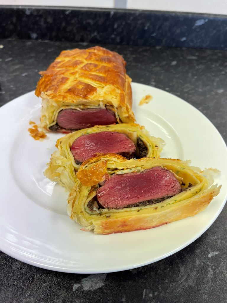 Venison Wellington with a Mushroom Duxelle and Game Juis